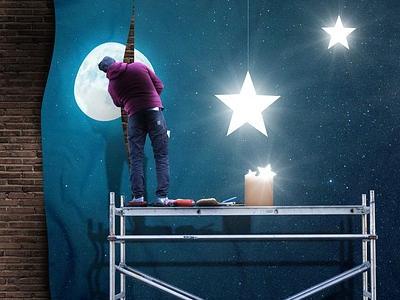 Mann auf Arbeitsbühne dekoriert eine Wand